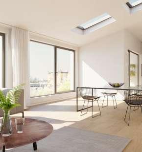 Moderner offener Wohnbereich mit Essplatz und Küche